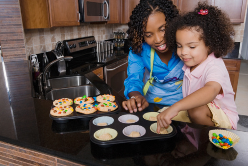 African mother and daughter making cupcakes.jpg